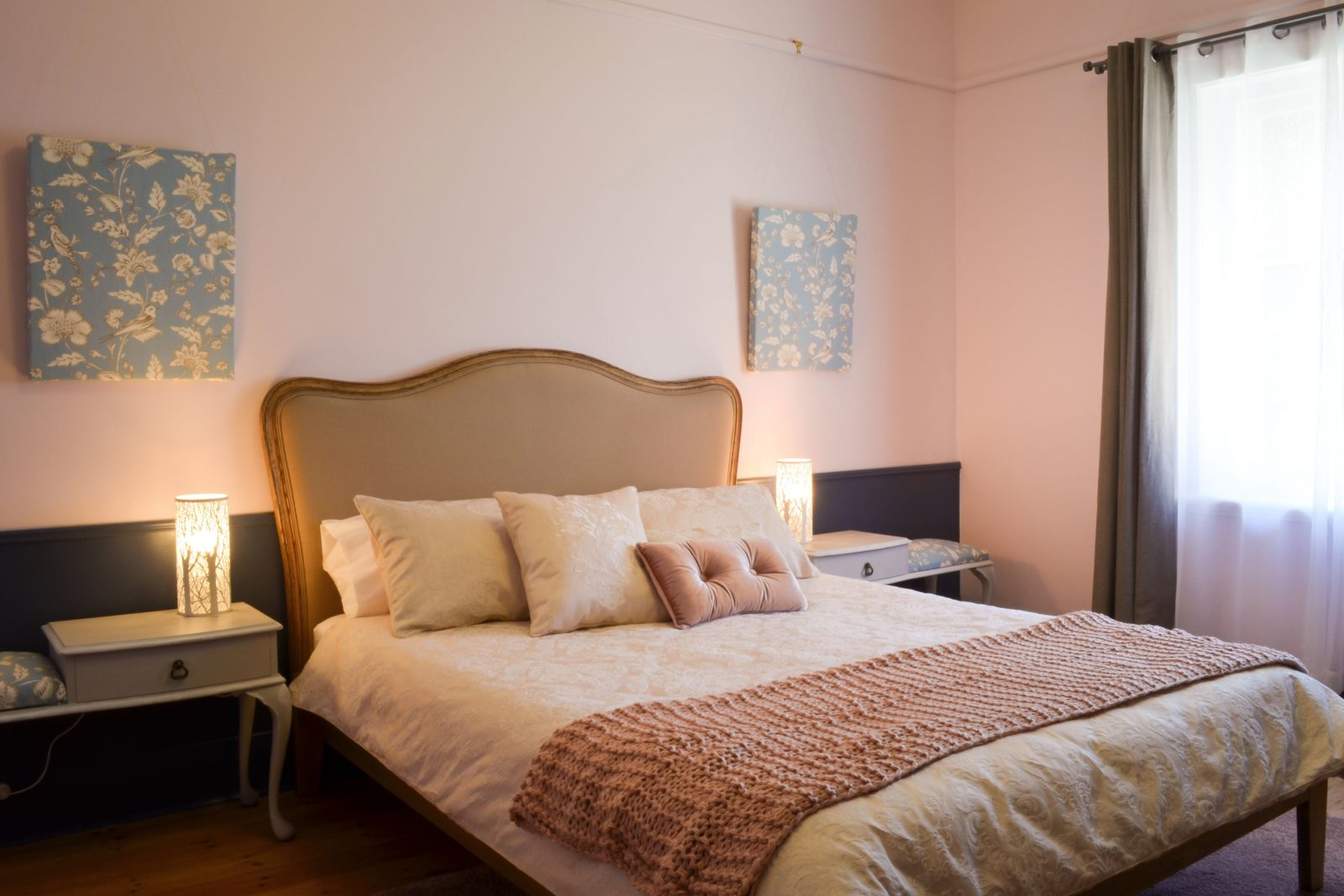 Deluxe Queen Bedroom; wooden floors, telephone table bedsides with seating