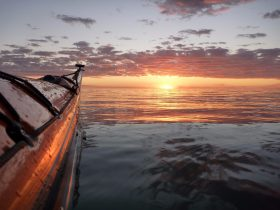 Calm seas, a sea kayak and a sunset. South Australia sea kayaking.