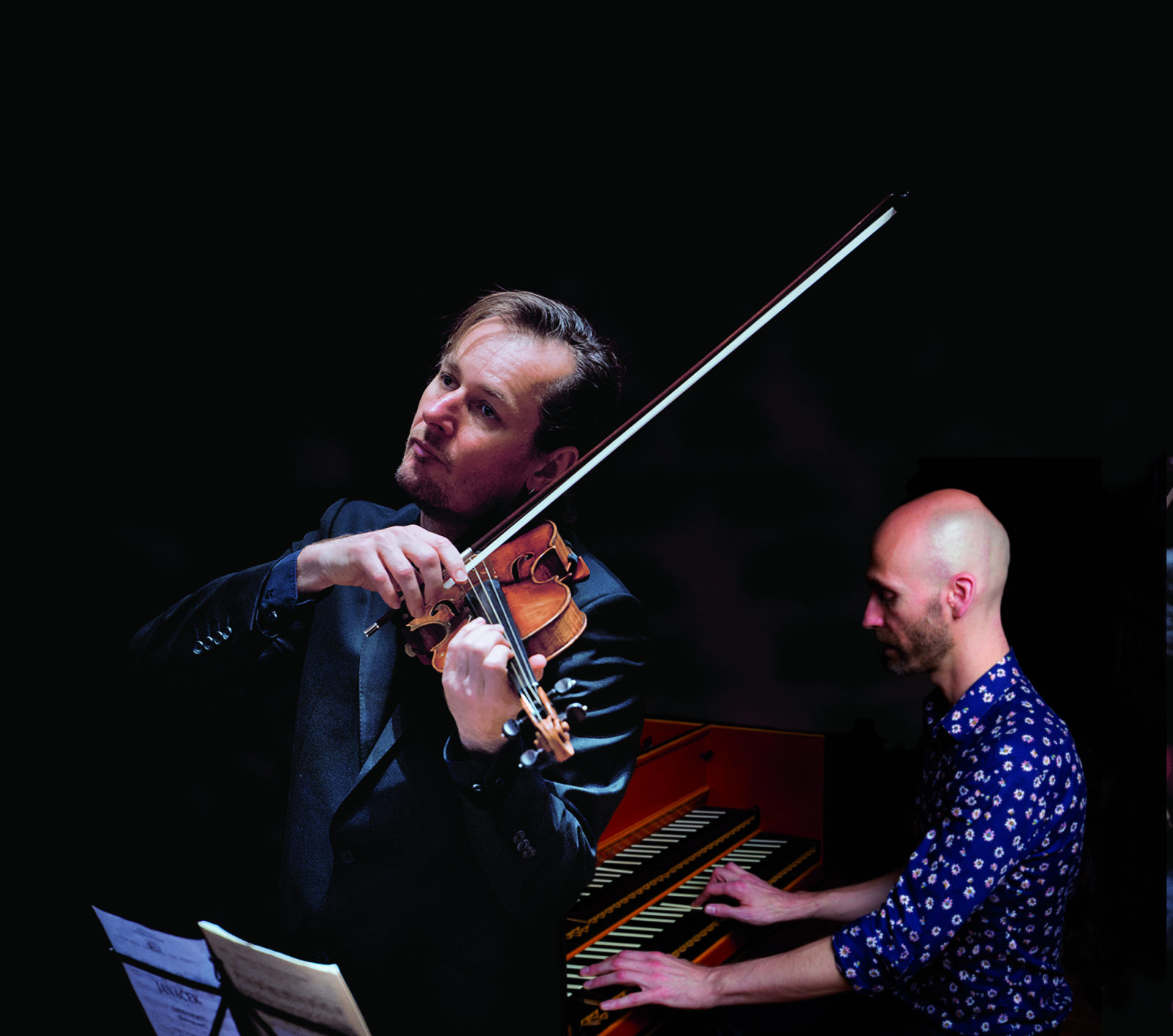 Tognetti and Helyard playing their instruments