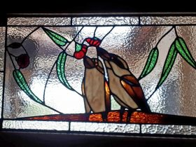 Kookaburra leadlight window with gum leaves and gumnuts