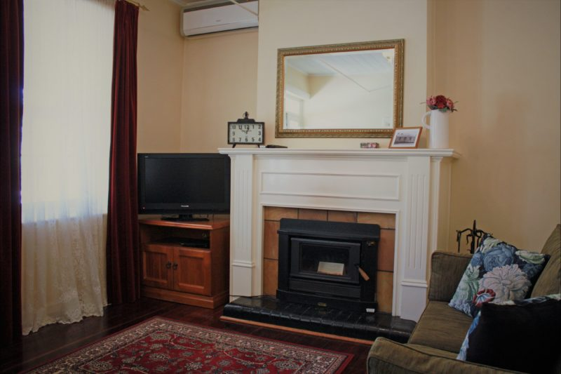 Lounge room with wood combustion heater