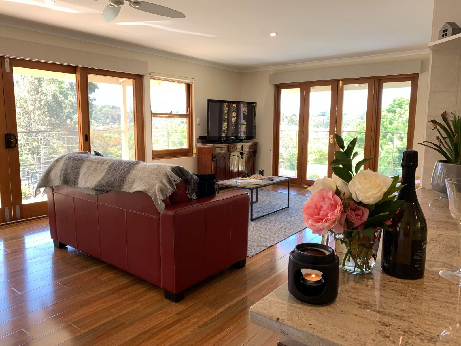 The Hahndorf Luxury Apartment Lounge dining room has a beautiful balcony to sit on