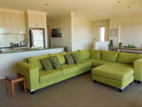 LOUNGE ROOM, KITCHEN, DINING - OPEN PLAN LIVING THE SOFA PERFECTLY PLACED TO SOAK IN THE VIEW