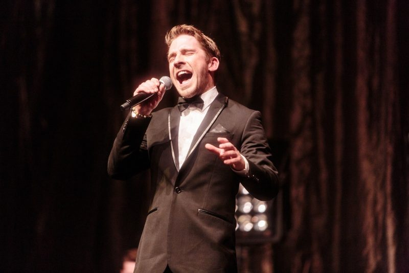 Hugh Sheridan sings into a microphone