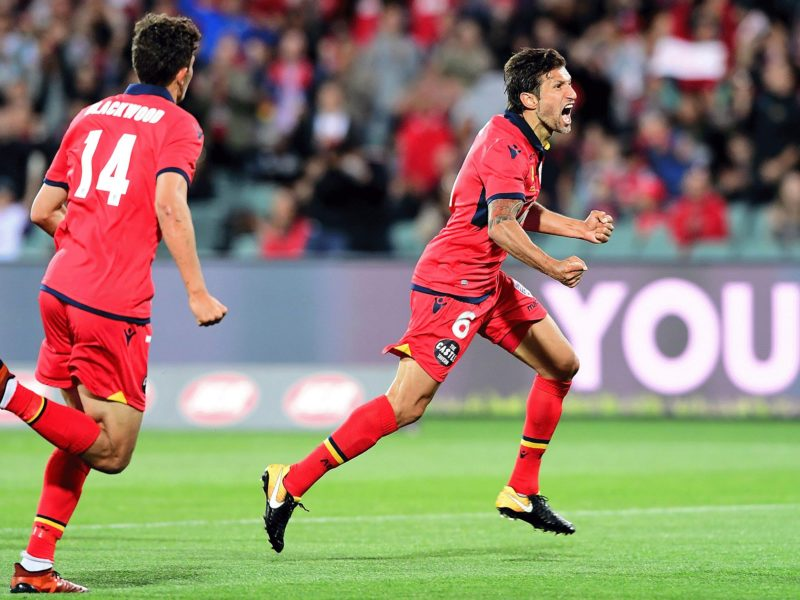 Adelaide United's Vince Lia celebrates scoring against the Victory.