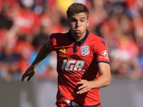 Nathan Konstandopoulos on the ball as he looks to kick-start an Adelaide attacking move.
