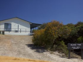 View of Island Time from Sunset Way showing driveway and entrance steps