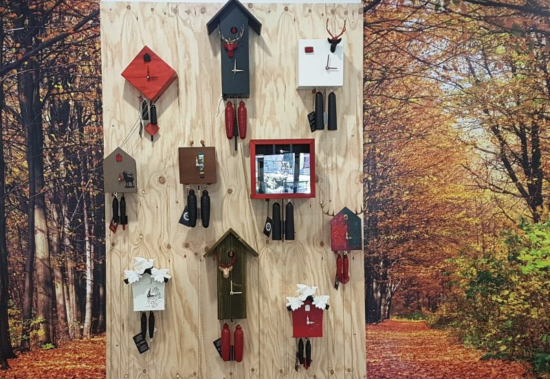 Contemporary Design outside - Traditional Cuckoo Clock inside from the Black Forest Germany