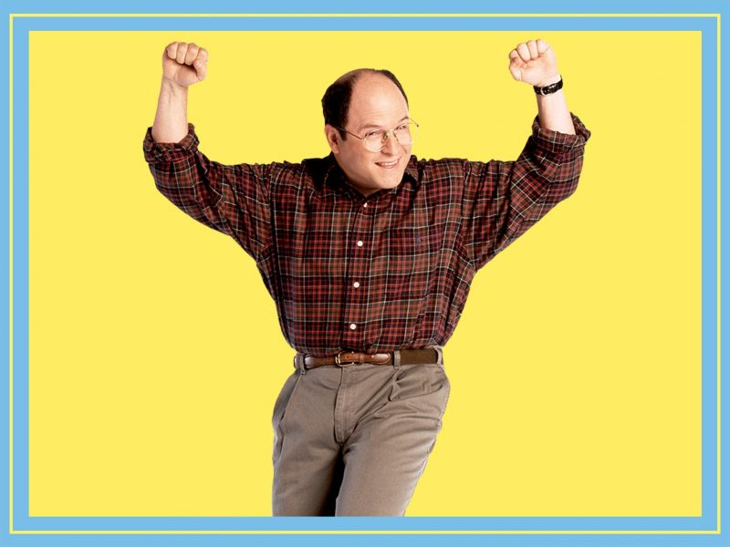 Jason Alexander is cheering with two fists in the air