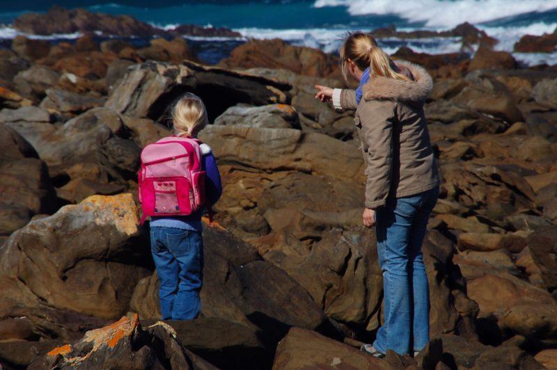 Woman and Child exploring D' Estrees Bay Kangaroo Island in winter