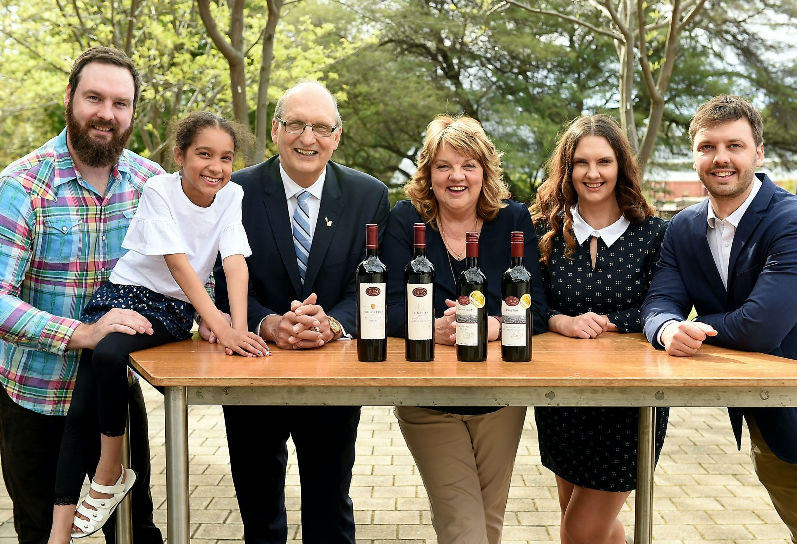 kies family with wine