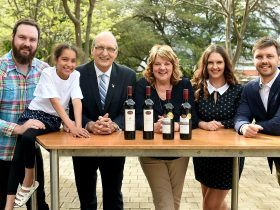 kies family with wine