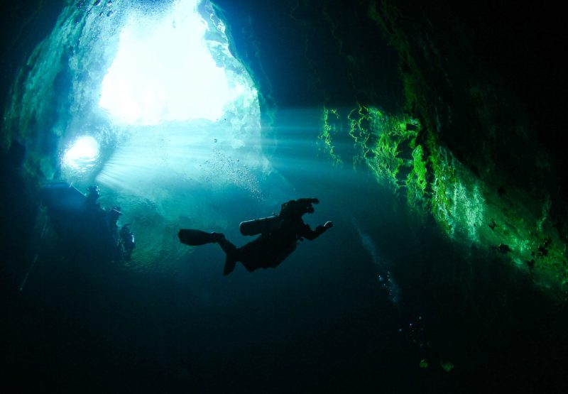 Image of a diver taken from the depths of Kilsby Sinkhole, looking towards the surface.
