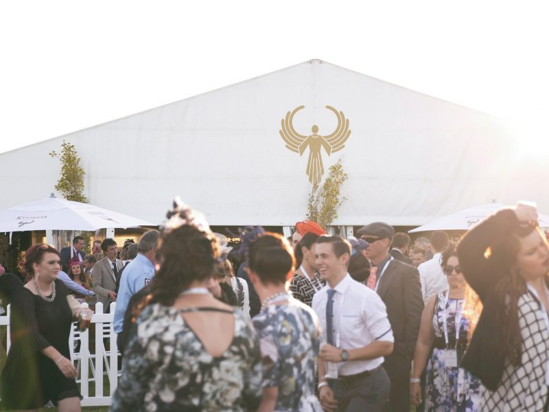 People gather in front of Country horse racing marquee