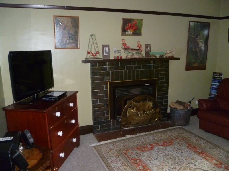 Lounge with wood fire and leather lounge with 2 recliners