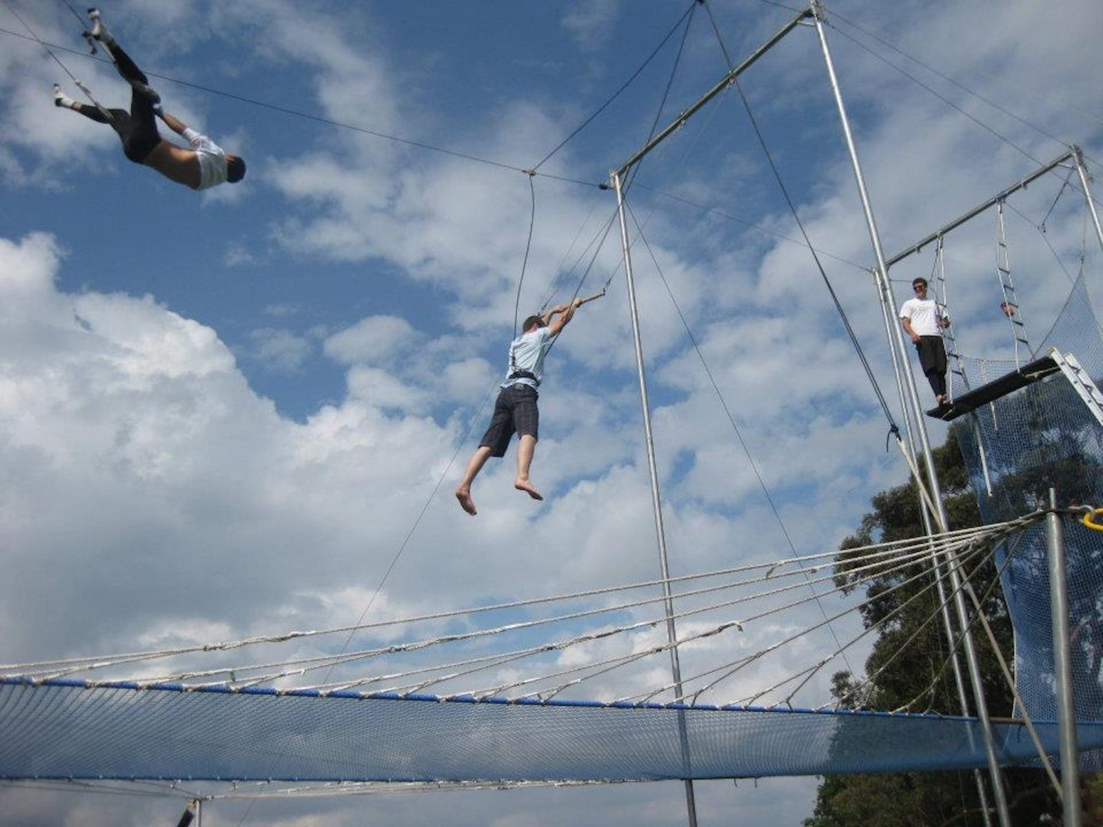 Two people try acrobatics on the Listo Trapeze