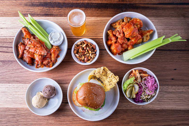 food including a Burger, Wings, Buffalo Cauliflower, Kimchi, Ice Cream