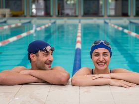Photo of man and woman in a swimming pool