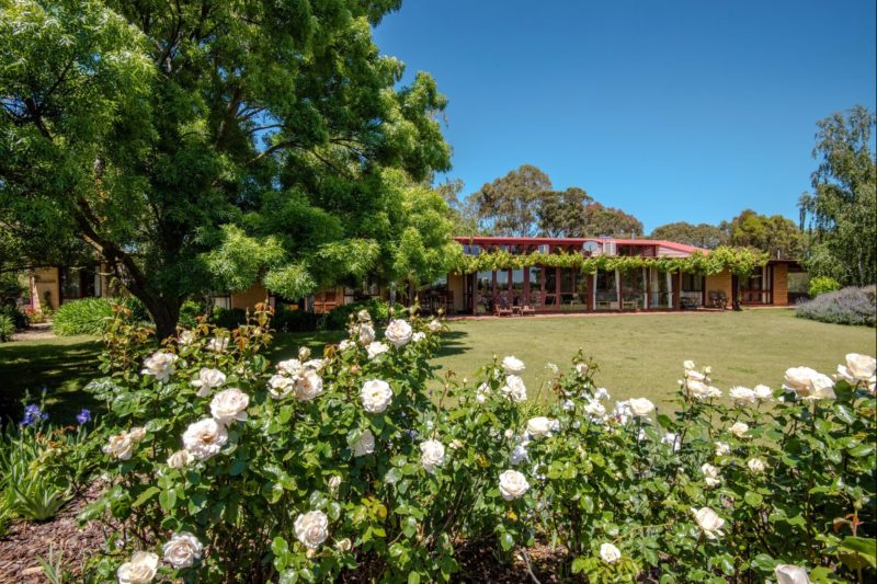 View of the Lodge form the lawned rose garden