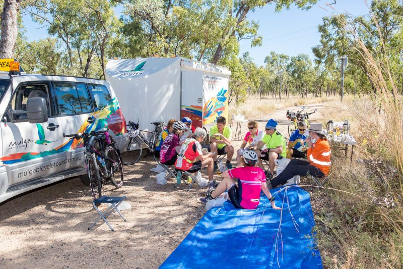 Cyclists on a Mulga Bicycle Tour gather for lunch
