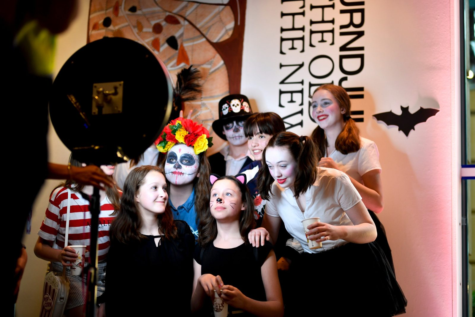 A group of young people enjoying Neo Deadly Halloween in 2018,