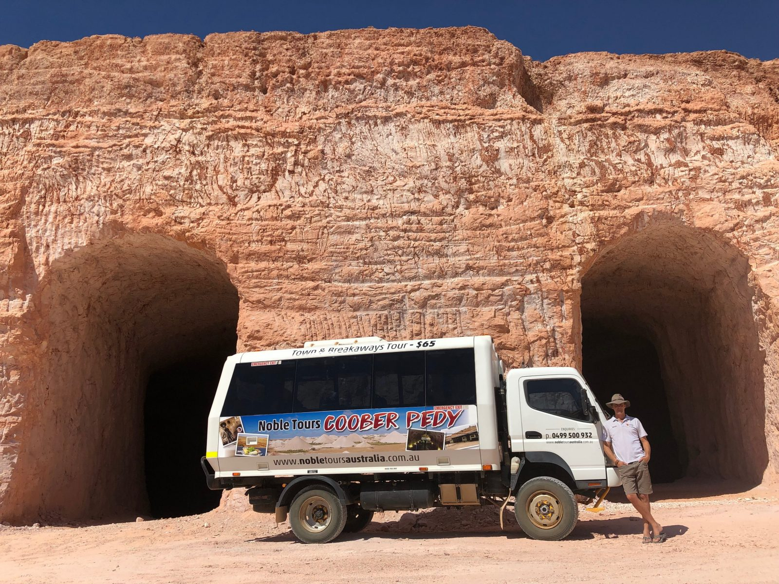 Noble Tours bus and driver
