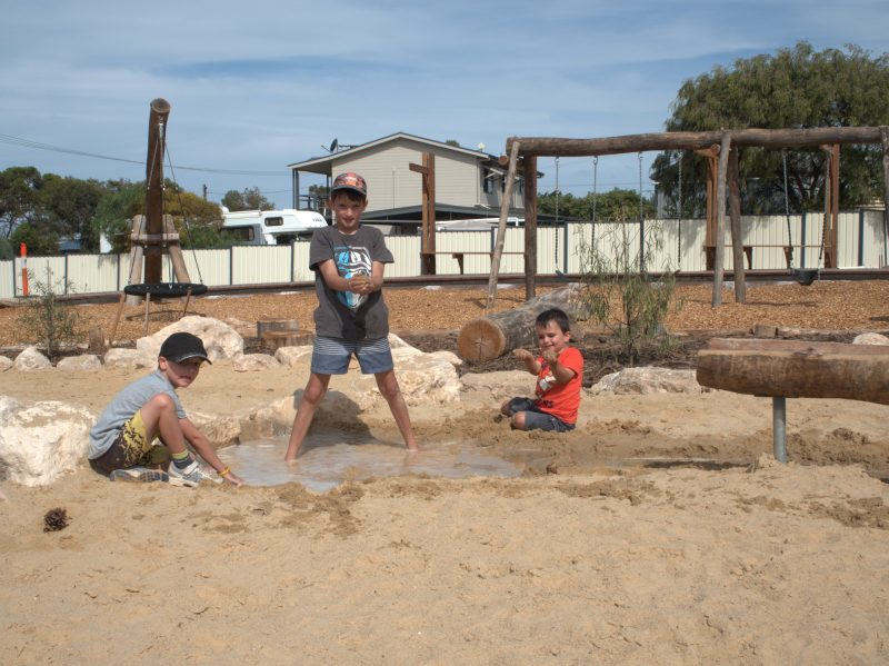 Hudson, Riley and Lachlan Forbes enjoying the new Playspace
