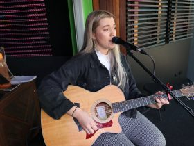 A live performance at Alma Open Mic Night