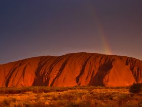 rainbow on Uluru at sunset