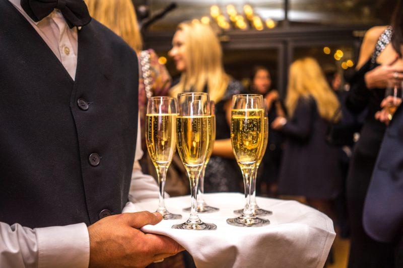 Waiter serving sparkling wine