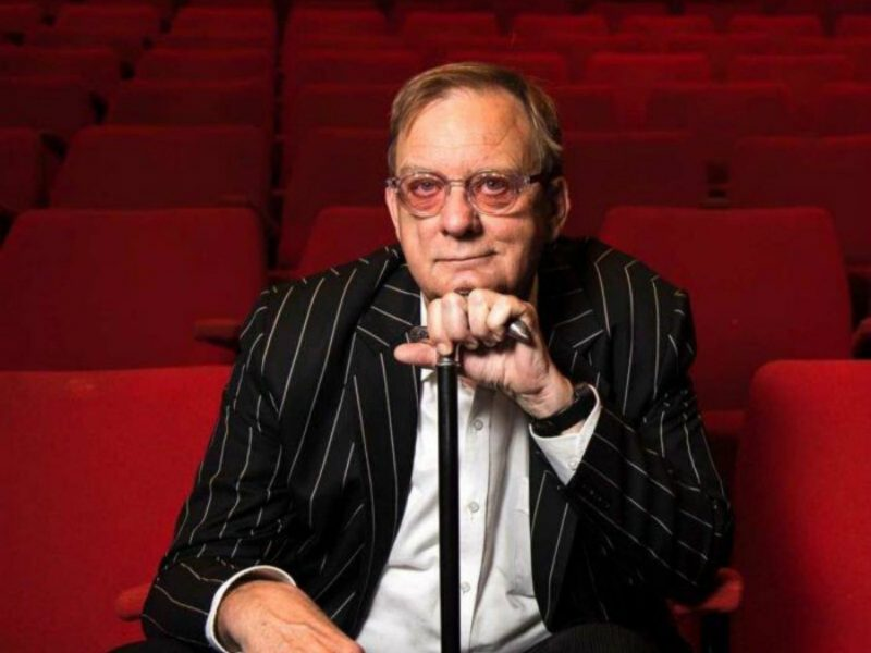 Peter Goers sits in a theatre