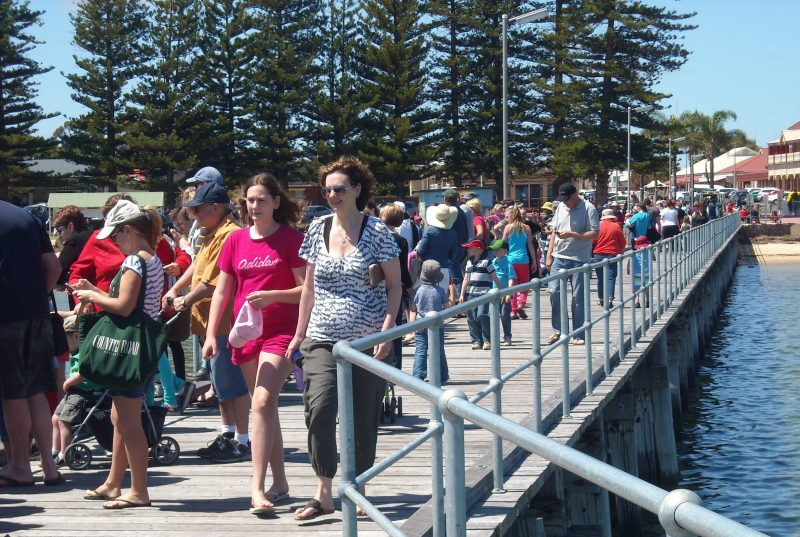 Excited rubber duck owners watching their ducks race from the Pt Broughton Jetty