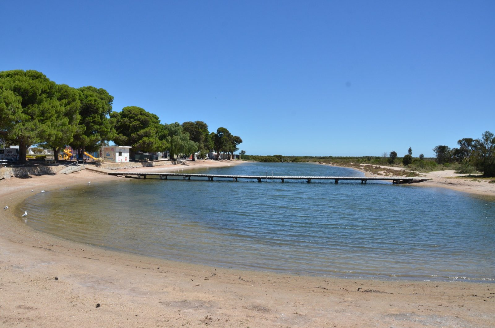 Tidal saltwater swimming pool adjacent to caravan park