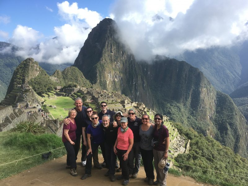 Big Heart Adventures Challenge Treks. Group of hikers standing in front of Machu Picchu in Peru