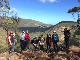Big Heart Adventures Wise Women Walking program. Women hikers standing on trail in Flinders Ranges
