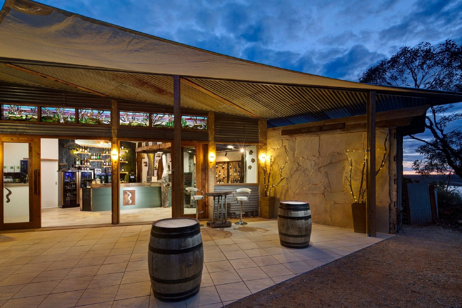 Exterior alfresco area at night of the Riverland Wine Centre