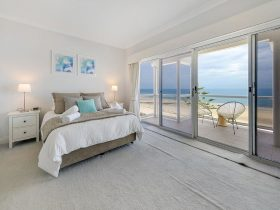 Fantastic views of the beach with chairs on the balcony to sit back, relax and enjoy the sunsets.