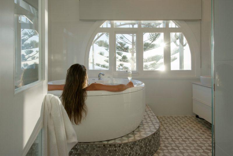 1 perosn relaxing in the spa bath, enjoying the view