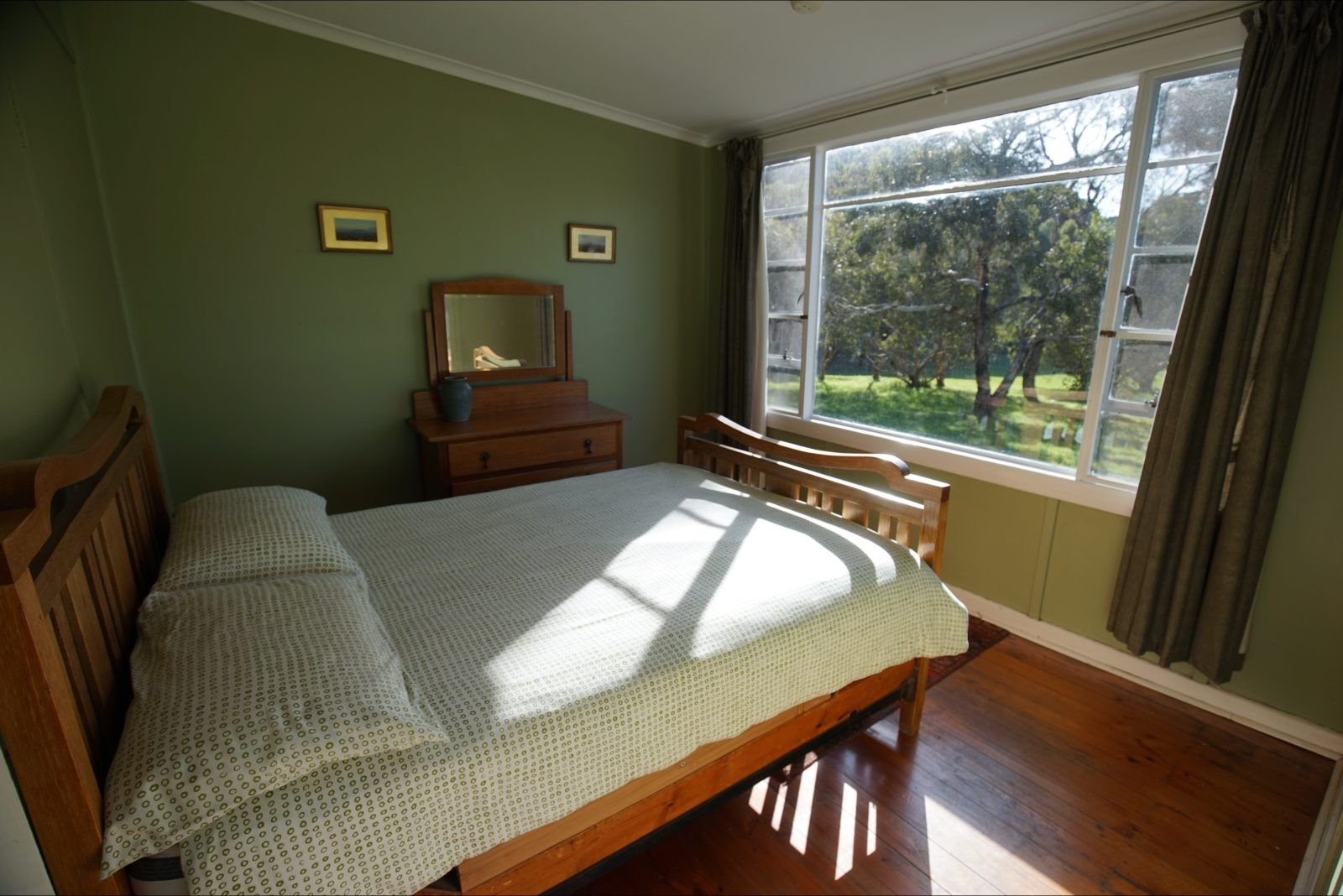 The main bedroom overlooks the stringybark forest and is next to the sunrroom