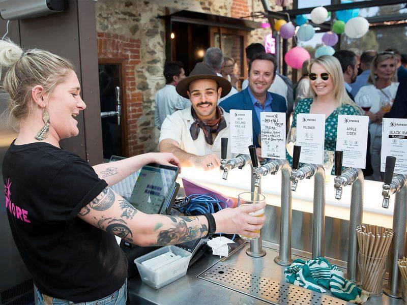 Bartender pouring drink rooftop bar