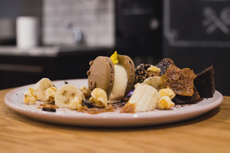 Macaron, St. Louis Ice Cream, Dark Chocolate, Chocolate Sponge, Dulche De Leche, Banana and more!