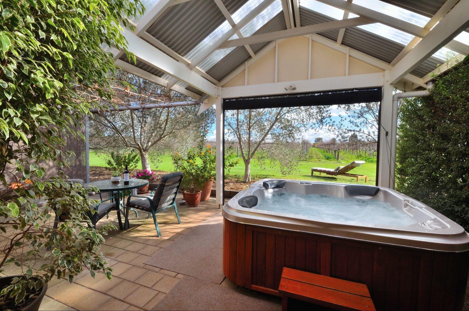 Veranda overlooking vineyard, outdoor heated spa