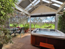 Veranda overlooking vineyard, outdoor heated spa