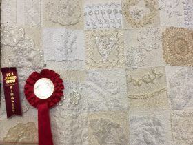 Heirloom Quilt - a queen size quilt constructed using vintage laces and doilies.