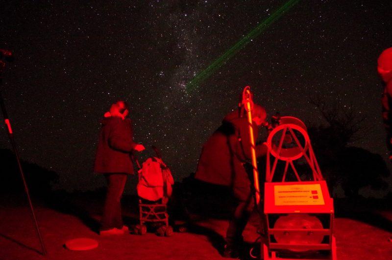 Grandma looks through our telescope at Wirrina