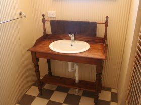 Beautiful but functional old style vanity in the bathroom