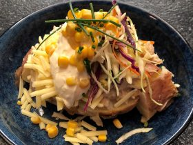 Potato topped with tuna mornay, cheese, slaw, corn, sour cream and chives