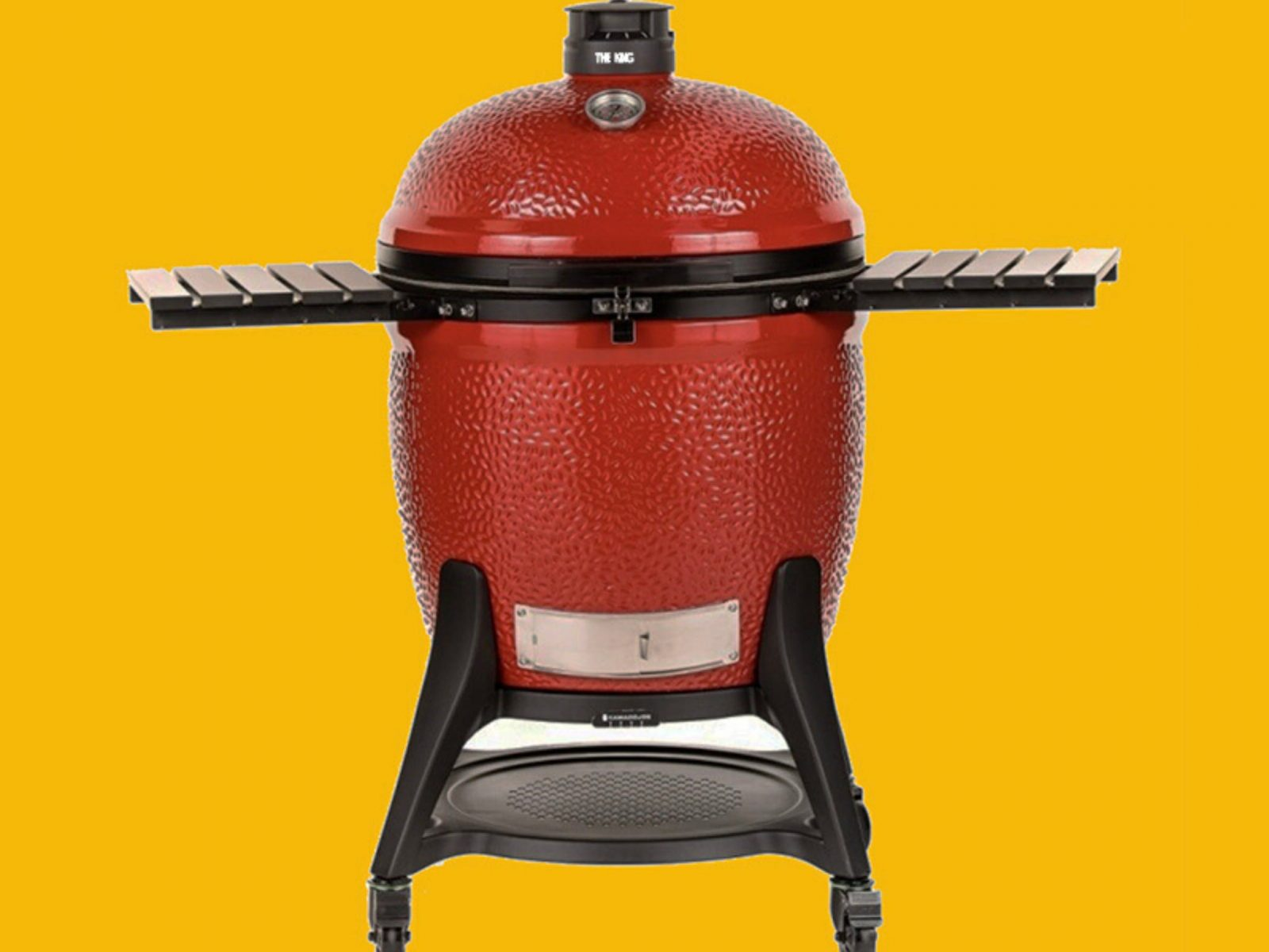 A bright red barbeque sits on a yellow background.