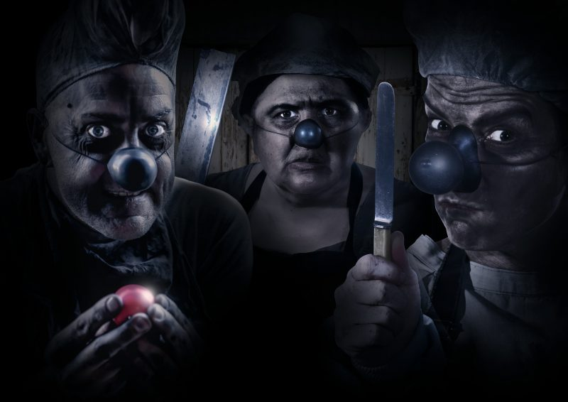 There are three dangerous and dirty clowns, one hods a red nose and two hold knives and cleavers.