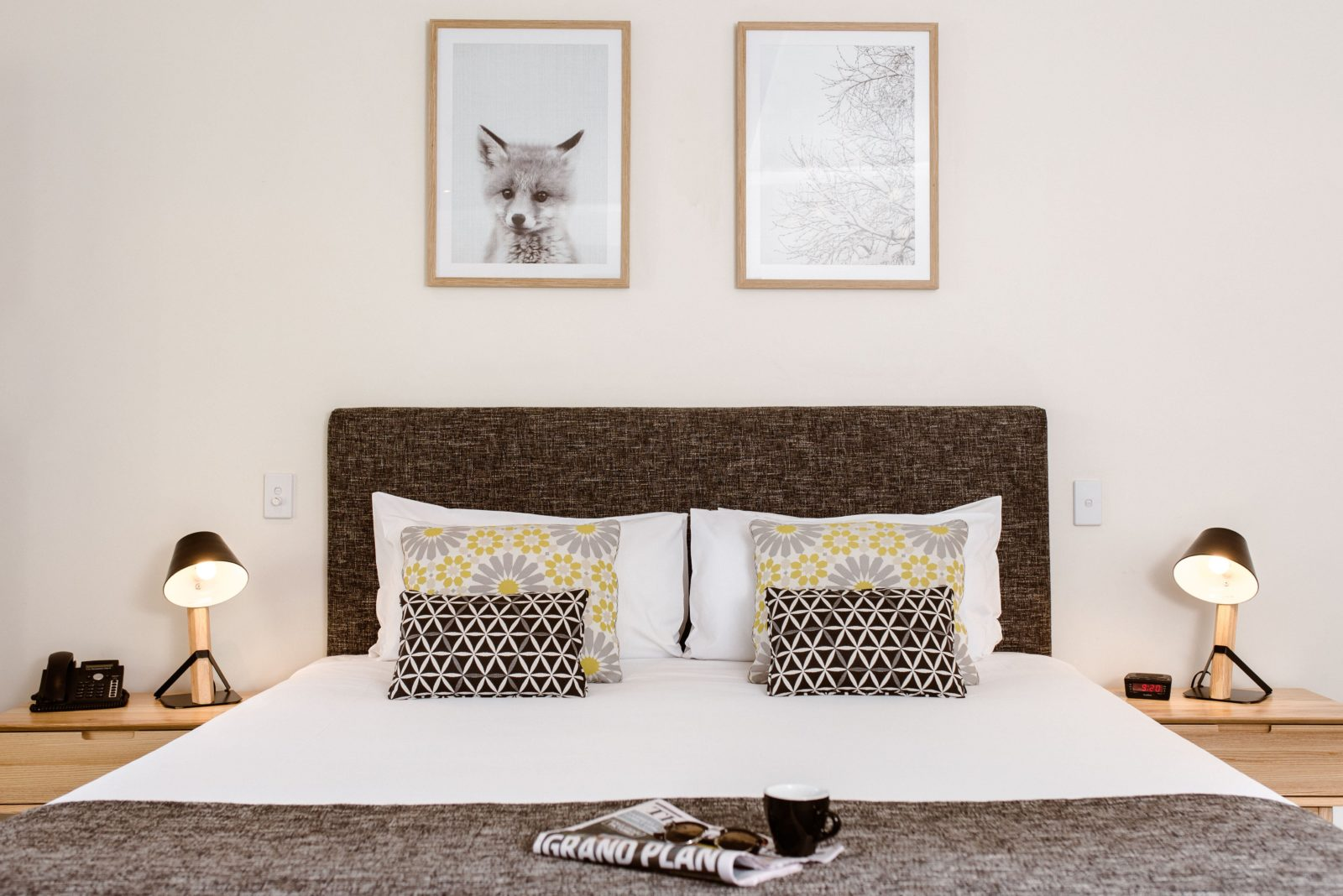 A king-sized bed with Scandinavian-style furnishings